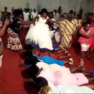 newly wedded couples climbed on guests at their wedding ceremony