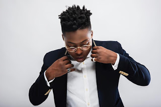 Reekado banks share throwback photo of him and his mother