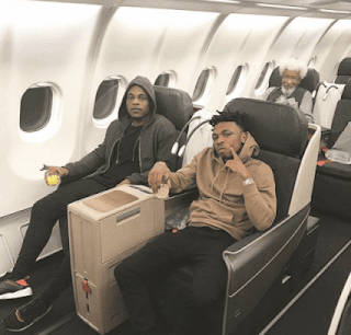 Mayorkun And LAX Pictured With Prof. Wole Soyinka On Flight