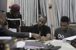 Davido signing Mayorkun