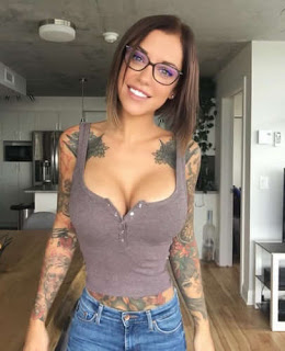 Laurence bedard with tattoos all over her body
