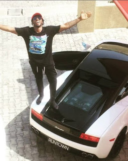 Runtown's beside his brand new car