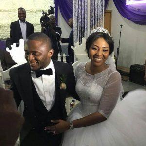 Lilian Esoro and Ubi Franklin white wedding