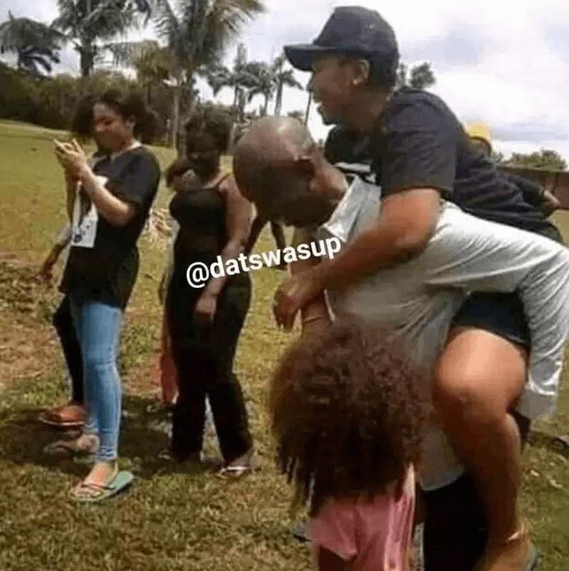 Ned Nwoko carrying Regina Daniel on his back
