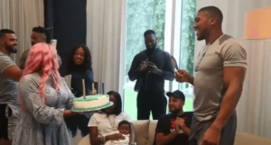 watch as DJ Cuppy welcomes Anthony Joshua With a cake