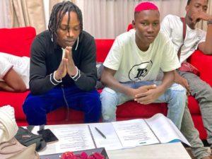 Naira Marley signing zinoleesky photo
